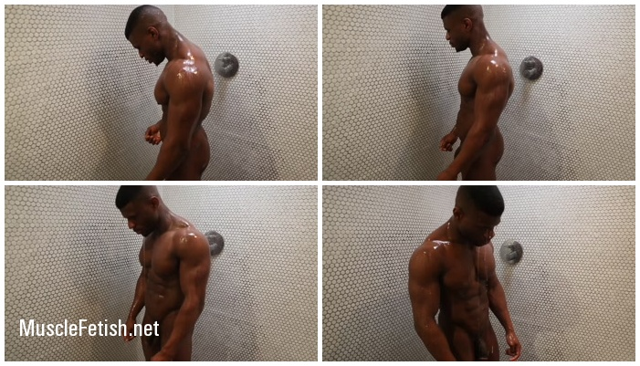 Beautiful muscular black athlete in shower