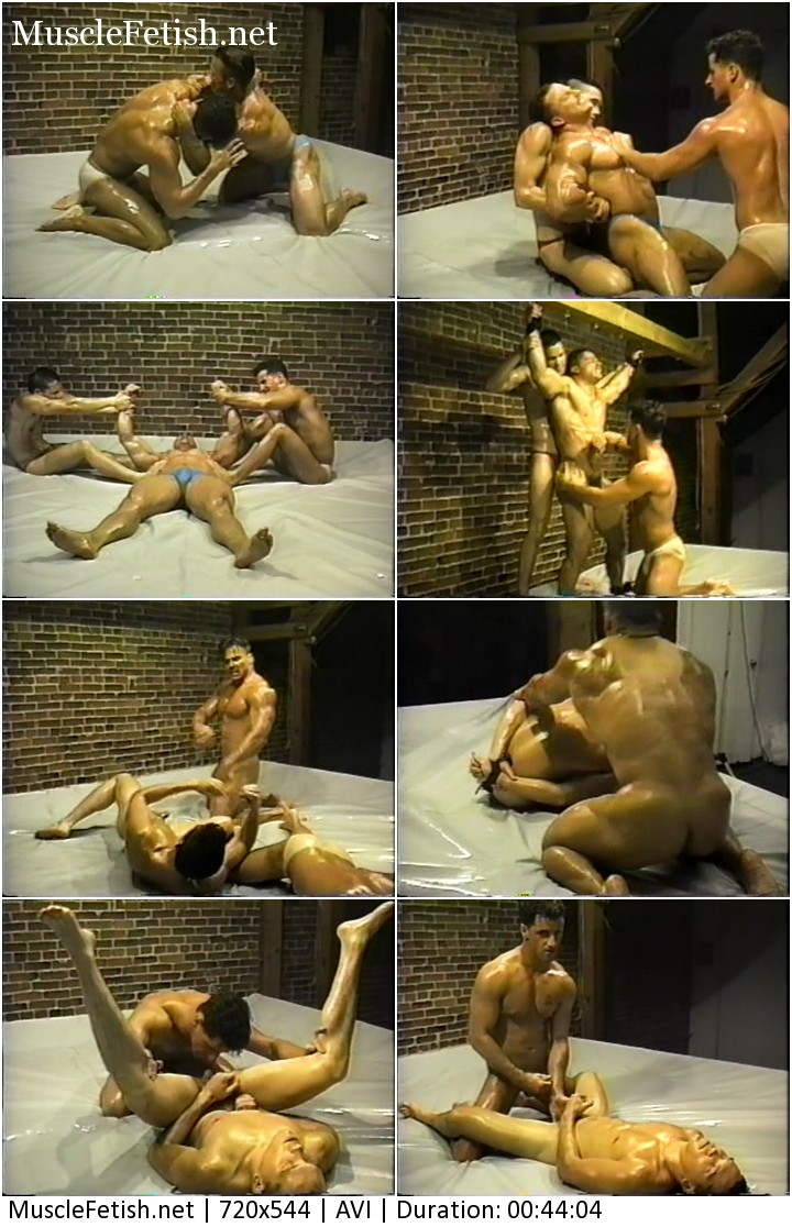 Gay bondage in oil muscle fight.