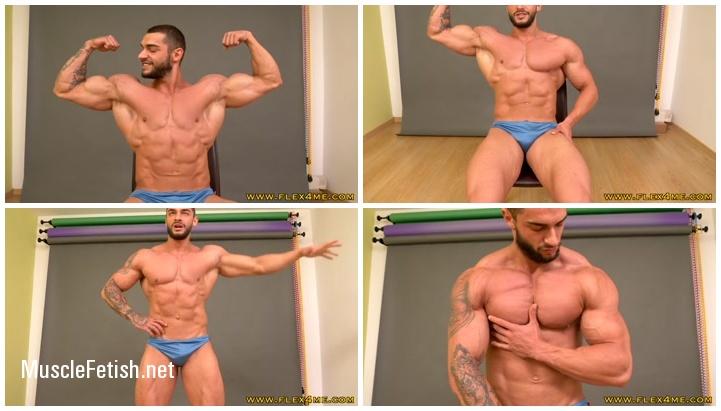 Hot muscular model Carl flex his biceps
