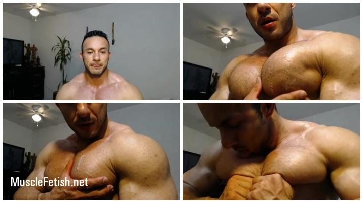 Muscle hunk grabbing pecs - sexy posing on cam