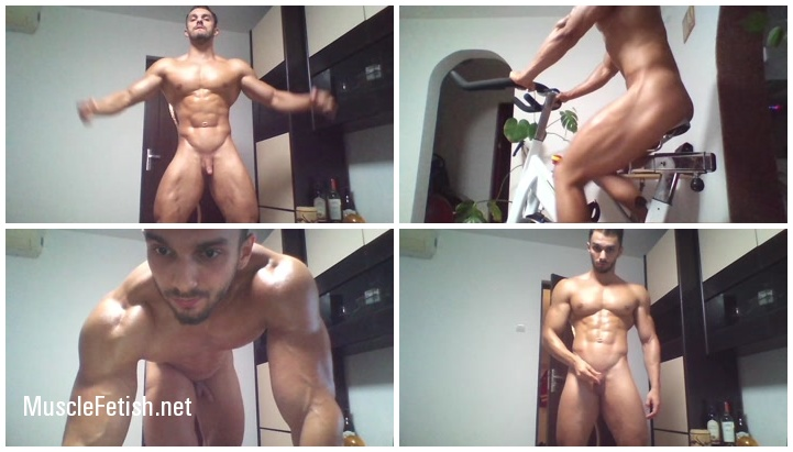 Naked fitness man on a stationary bike