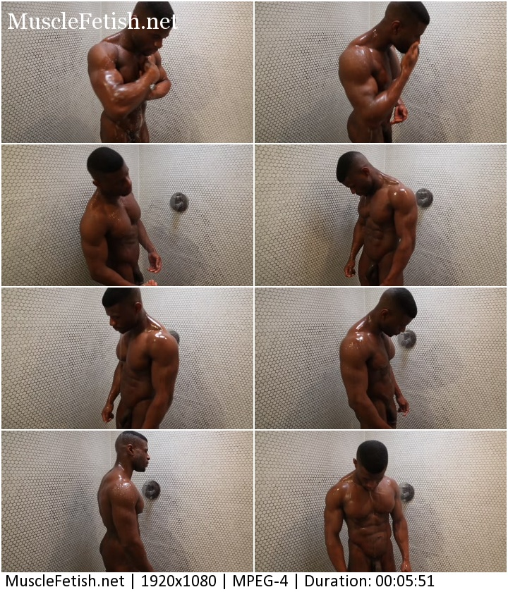 Sexual black bodybuilder posing naked in shower