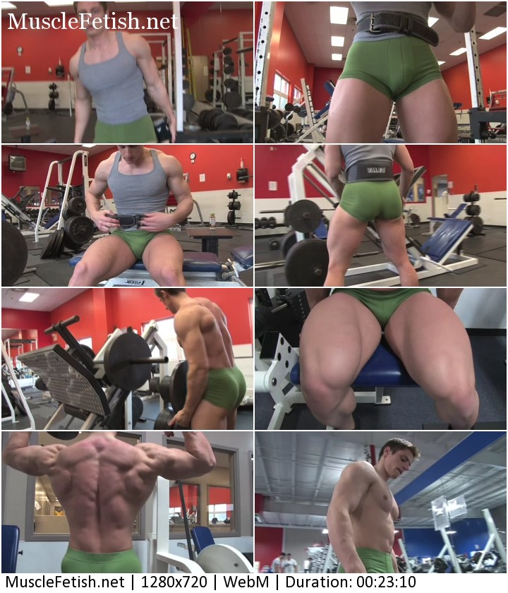 Young muscular guy Ryan Nelson working out and posing at the gym